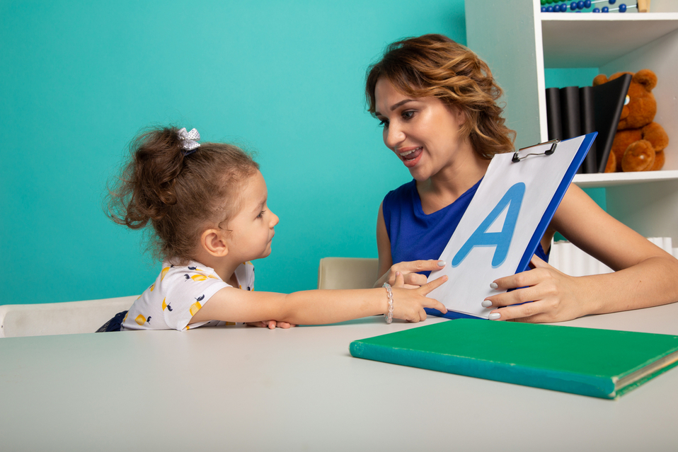 speech and language pathologist spending instructor with a small girl